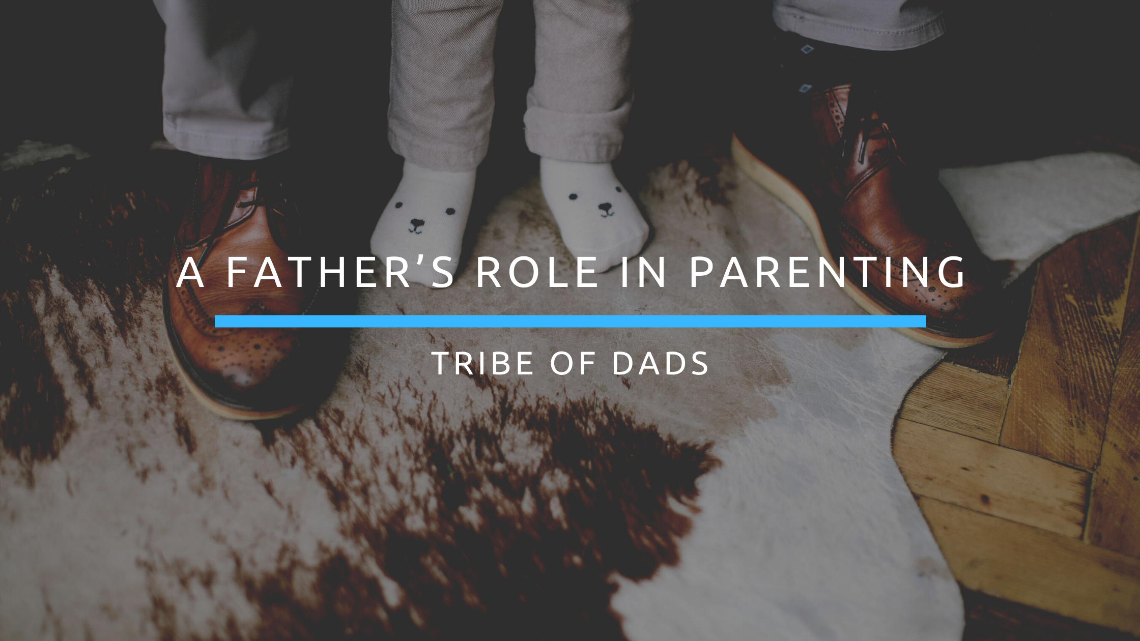 "A Father's Shoes With Son's Feet In Between With The Caption ""A Father's Role In Parenting"""