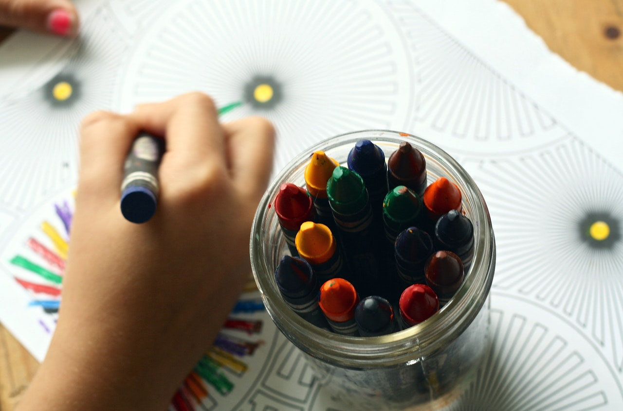 A child coloring a photo for his father